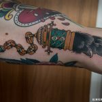 Neotraditional claw tattoo