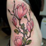Magnolia flowers ribs tattoo